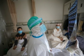 The WHO team is due to visit China and the city of Wuhan, as it investigates the origins of a pandemic in which nearly 1.9 million people have now died [File: China Daily via Reuters]