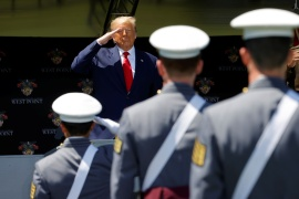 US President Donald Trump salutes as he prepares to deliver the commencement address at the 2020 United States Military Academy Graduation Ceremony in West Point, New York, US [File: Mike Segar/ Reuters]