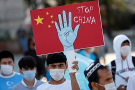 Ethnic Uighur demonstrators take part in a protest against China, in Istanbul, Turkey in October, 2020 [File: Murad Sezer/Reuters]