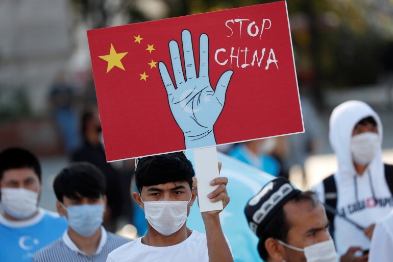 Ethnic Uighur demonstrators take part in a protest against China in Istanbul, Turkey on October 1, 2020 [File: Murad Sezer/Reuters]