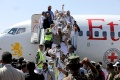 Freed Houthi prisoners arrive after their release in a prisoner swap, in Sanaa airport, Yemen October 15, 2020 [Khaled Abdullah/Reuters]