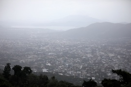 The city of San Salvador is seen from the San Salvador volcano during rain caused by tropical storm Eta, on November 4, 2020 [File: Jose Cabezas/Reuters]