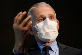 Dr Anthony Fauci, the top US infectious disease expert, said on Thursday that based on recent seven-day averages, coronavirus infections may be about to hit a plateau in the United States [Patrick Semansky/Pool via Reuters]