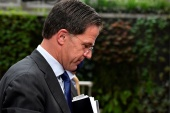 Rutte, 53, resigned along with his cabinet over a dispute that saw thousands of families wrongly accused of child benefit fraud [John Thys/Pool via Reuters]