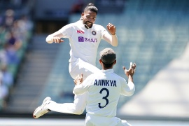 Siraj celebrates with Ajinkya Rahane after dismissing Australia's Marnus Labuschagne during the second Test match between Australia and India at Melbourne [File: Scott Barbour/AAP Image via Reuters]