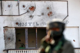 Bullet holes seen on the wall of a house after a gun battle between Indian army soldiers and suspected rebels on the outskirts of Srinagar on December 30, 2020 [Danish Ismail/Reuters]