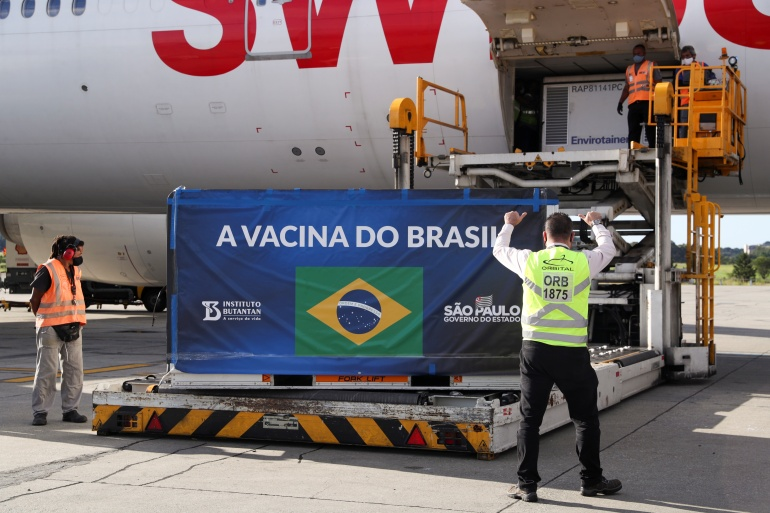 A refrigerated container with China's Sinovac COVID-19 vaccines arrives at Sao Paulo International Airport in Guarulhos, Brazil December 30, 2020 [Amanda Perobelli/Reuters]