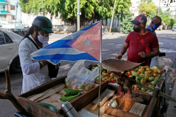 People buy vegetables at a street stall in Havana, Cuba on December 29, 2020 [File: Stringer/Reuters[