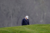 US President Donald Trump plays golf at the Trump National Golf Club in Sterling, Virginia [File: Joshua Roberts/Reuters]