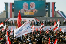 Iraqis gather to mark the first anniversary of the killing of Iranian General Qassem Soleimani and Iraqi militia leader Abu Mahdi al-Muhandis [Khalid Al-Mousily/Reuters]