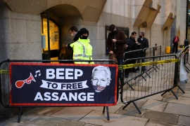 A banner hangs outside the Old Bailey, the Central Criminal Court before WikiLeaks founder Julian Assange's arrival, in London, UK, January 4, 2021 [Henry Nicholls/Reuters]