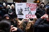 People react after a judge ruled that WikiLeaks founder Julian Assange should not be extradited to the United States, outside the Old Bailey, the Central Criminal Court, in London on January 4, 2021 [Henry Nicholls/Reuters]