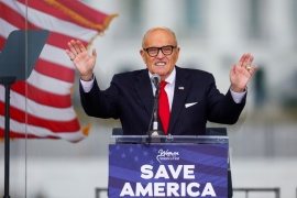 Dominion's defamation suit against Giuliani comes after the bogus conspiracy of election fraud helped inspire a deadly insurrection at the United States Capitol on January 6 following a rally at which Giuliani and former President Donald Trump spoke [File: Jim Bourg/Reuters]