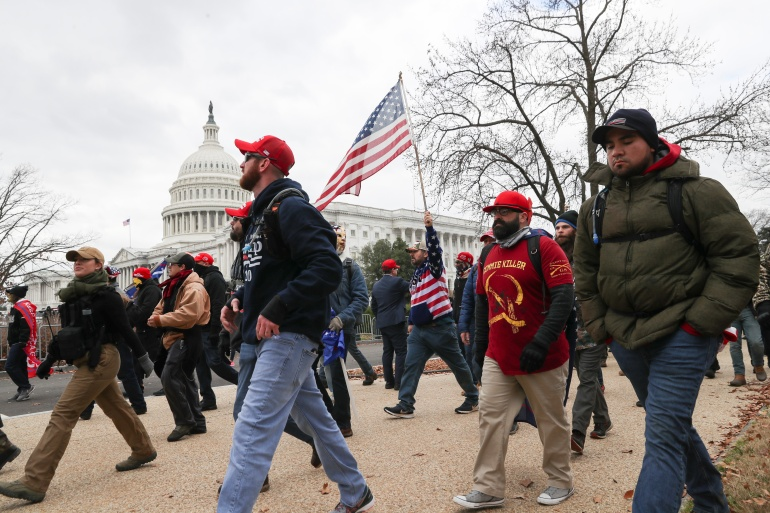 Members of the the far-right group Proud Boys march to the US Capitol on January 6 [File: Leah Millis/Reuters]