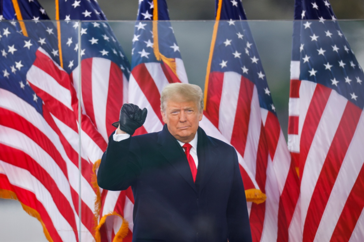 US President Donald Trump makes a fist during a rally to contest the certification of the 2020 US presidential election results by the U.S. Congress, in Washington. [Jim Bourg/Reuters]