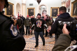 A supporter of United States President Donald Trump confronts police as Trump supporters demonstrate on the second floor of the US Capitol near the entrance to the Senate after breaching security defenses, in Washington, DC, the US on January 6, 2021. REUTERS/Mike Theiler