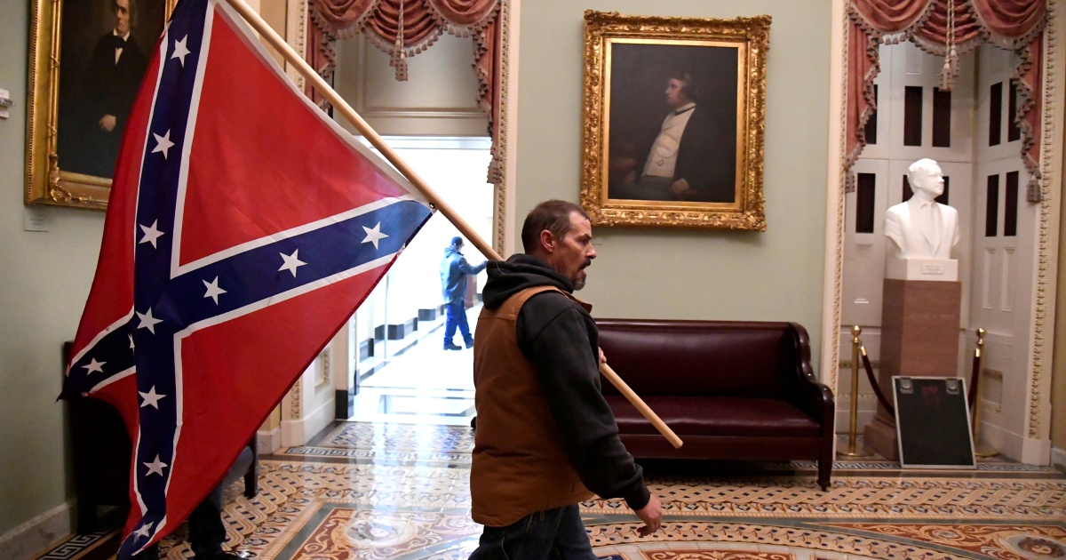 Man holding Confederate flag during US Captiol riot arrested | Crime News