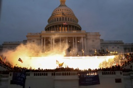 An explosion caused by a police munition is seen while supporters of US President Donald Trump gather in front of the US Capitol Building in Washington, DC on January 6, 2021 [Reuters/Leah Millis]