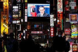 A large screen on a building shows the live broadcast of Japan's Prime Minister Yoshihide Suga declaring a state of emergency for Tokyo and three neighbouring prefectures, amid the COVID-19 outbreak, in Tokyo, Japan January 7, 2021 [Issei Kato/Reuters]