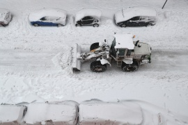 A bulldozer clears snow on a street in Madrid [Sergio Perez/Reuters]