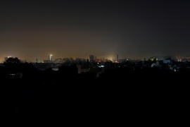 A general view of a residential area is seen during a power breakdown in Karachi [Akhtar Soomro/Reuters]