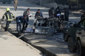 Afghan officials investigate the site of a bomb blast in Kabul, Afghanistan, on Saturday [Omar Sobhani/Reuters]
