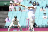Rishabh Pant of India hits a four during the third test match between Australia and India at Sydney [AAP Image/Dean Lewins via Reuters]