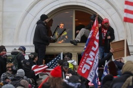 A mob of supporters of President Donald Trump climb through a window they broke as they storm the US Capitol Building on January 6 [Leah Millis/Reuters]