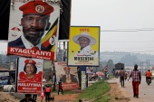 Elections billboards for Uganda's President Yoweri Museveni, and opposition leader and presidential candidate Robert Kyagulanyi, also known as Bobi Wine, are seen on a street in Kampala, Uganda January 12, 2021 [Baz Ratner/Reuters]