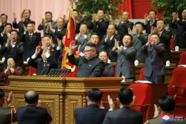 North Korean leader Kim Jong Un acknowledges the applause during the 8th Congress of the Workers' Party in Pyongyang. Kim pledged to develop the country's nuclear weapons, but also acknowledged severe economic problems [KCNA via Reuters]