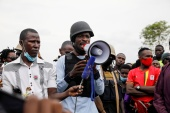 Bobi Wine wore a bulletproof vest and helmet in the weeks before the vote [Baz Ratner/Reuters]