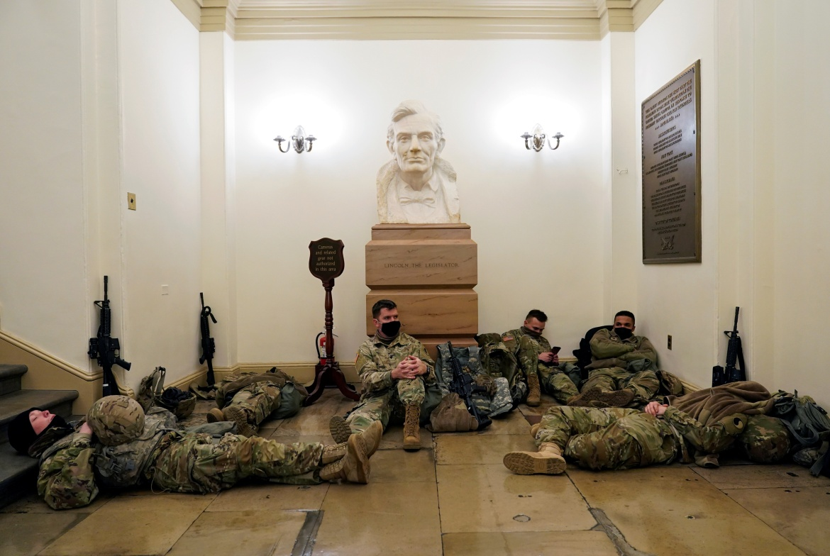 National Guard troops sleeping inside the Capitol building on Wednesday ahead of the session. [Joshua Roberts/Reuters]