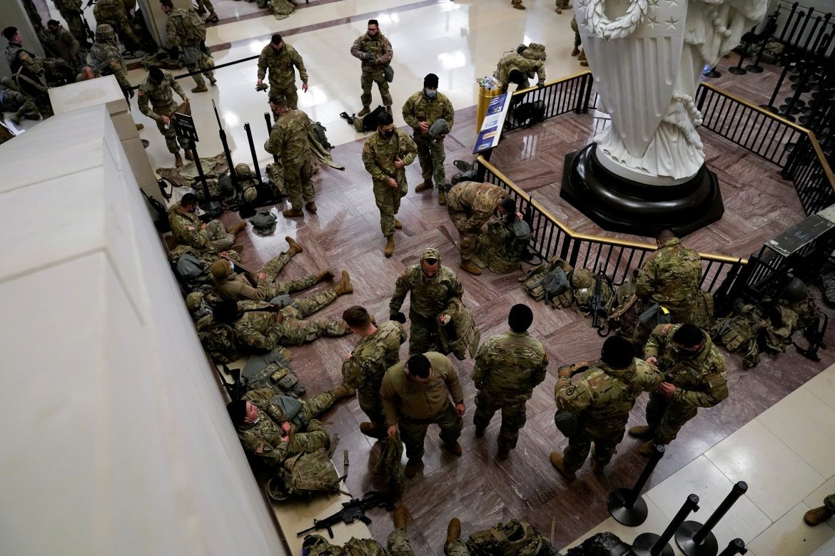 National Guard members assemble in the Capitol Visitor's Center on Capitol Hill before Democrats begin debating one article of impeachment against US President Donald Trump. [Joshua Roberts/Reuters]