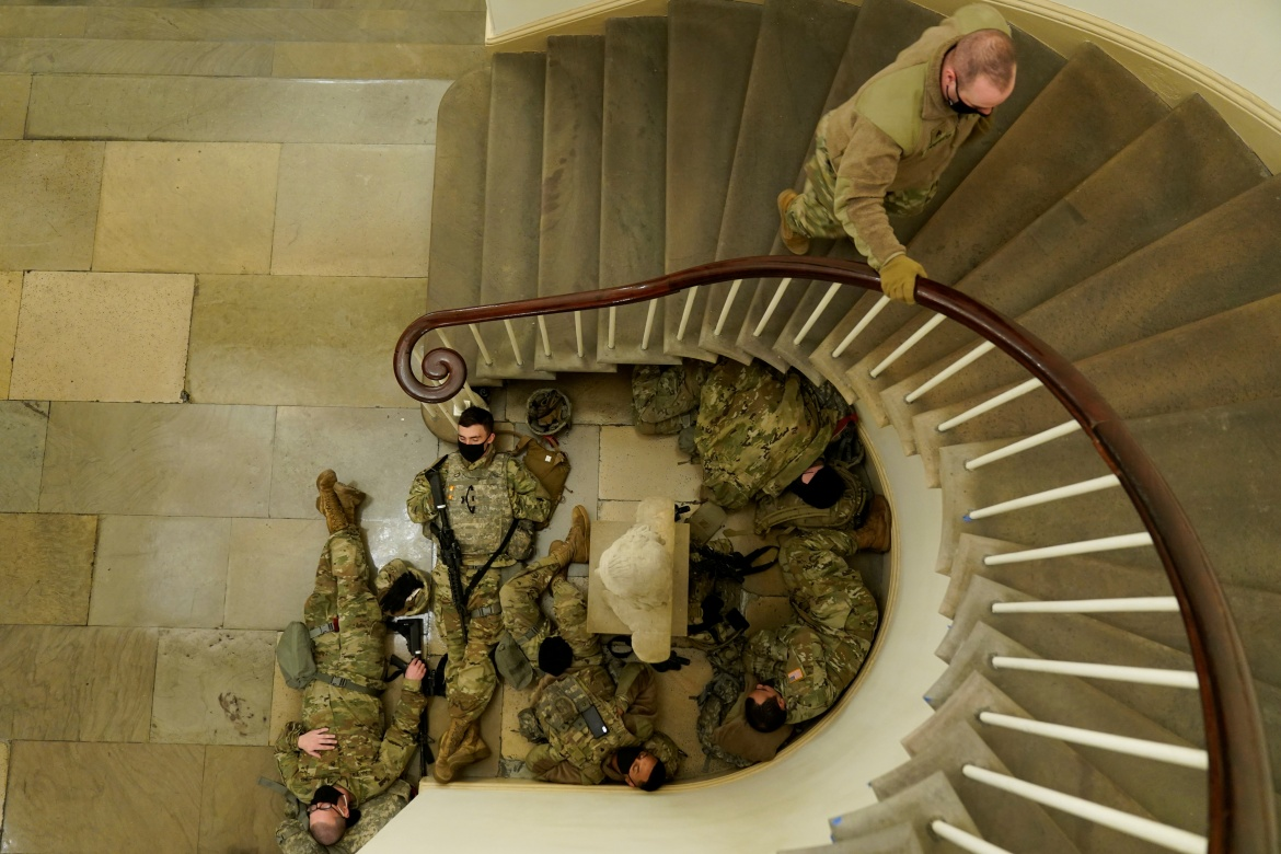 Security at the Capitol was tight, beefed up by armed National Guard troops, with secure perimeters set up around the Capitol complex, congressional offices and other buildings. [Joshua Roberts/Reuters]