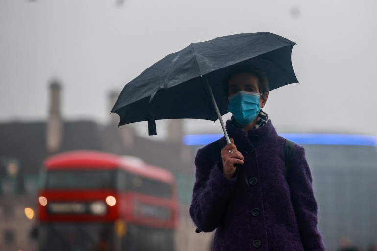 A woman wearing a face mask walks across deserted Westminster Bridge, as the spread of the coronavirus disease (COVID-19) continues, Britain January 13, 2021 [Hannah McKay/Reuters]