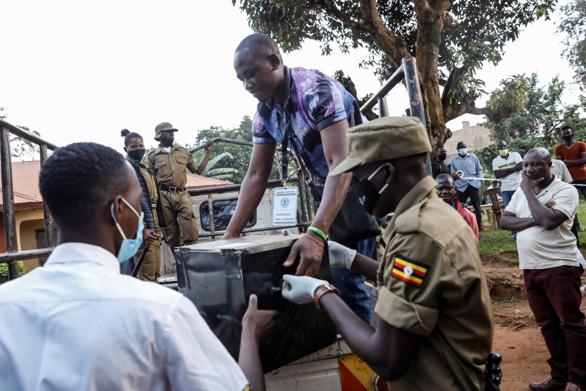 Voting materials for the presidential election checked upon arriving at a voting centre in Kampala. [Baz Ratner/Reuters]