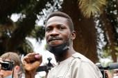Ugandan presidential candidate and singer Robert Kyagulanyi Ssentamu, known as Bobi Wine, gestures after casting his ballot [Baz Ratner/Reuters]