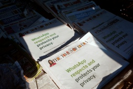 A WhatsApp advertisement is seen on the front pages of newspapers at a stall in Mumbai [Francis Mascarenhas/Reuters]