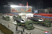 North Korea showcased new weapons at a night-time parade to mark the end of the ruling party's eighth congress [KCNA via Reuters]