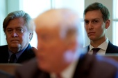 Former adviser Steve Bannon (back left) has been granted a pardon by outgoing President Donald Trump according to reports [File: Kevin Lamarque/Reuters]