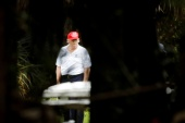Former President Donald Trump plays golf at the Trump International Golf Club in West Palm Beach, Florida, on December 30, 2020 [File: Marco Bello/Reuters]