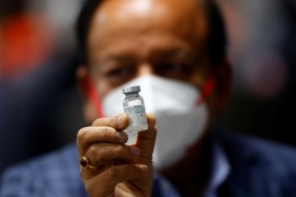 Health Minister Harsh Vardhan holds a dose of Bharat Biotech's vaccine during a vaccination campaign at All India Institute of Medical Sciences hospital in New Delhi last week [File: Adnan Abidi/Reuters]