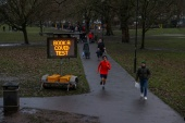 A sign urging residents to book a COVID-19 test is seen on Eel Brook Common as Britain continues its third lockdown in Fulham [Kevin Coombs/Reuters]