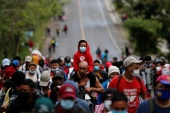 Thousands of Hondurans, pictured here in El Florido, Guatemala, have joined a new caravan bound for the United States [Luis Echeverria/Reuters]