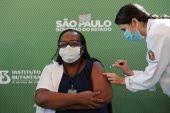 Nurse Monica Calazans, 54, receives the Sinovac coronavirus vaccine at Hospital das Clinicas in Sao Paulo, after Brazilian health regulator Anvisa approved its emergency use [Amanda Perobelli/Reuters]