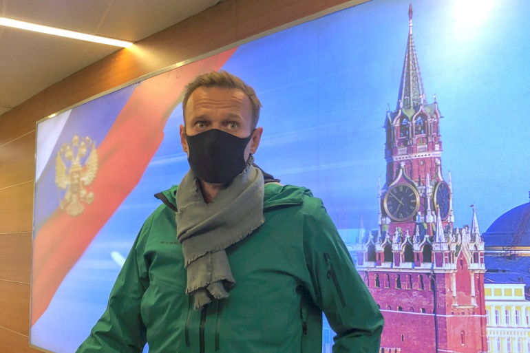 Russian opposition leader Alexey Navalny speaks with journalists upon the arrival at Sheremetyevo airport in Moscow, Russia January 17, 2021 [Polina Ivanova/Reuters]
