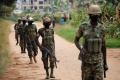 Soldiers patrol near the house of Bobi Wine in Kampala [Baz Ratner/Reuters]