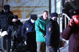 Russian opposition leader Alexey Navalny is escorted by police officers after a court hearing, in Khimki outside Moscow, Russia, January 18, 2021 [Evgeny Feldman/Meduza/Handout via Reuters]