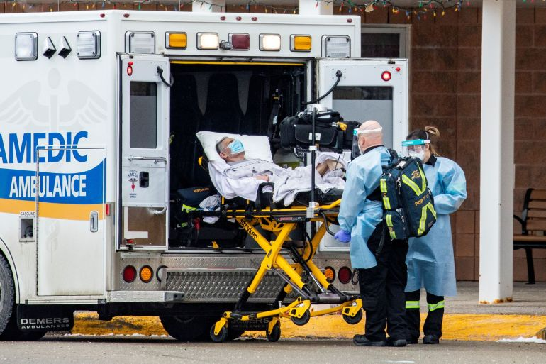 Paramedics transport a person from Roberta Place, a long-term elderly care facility in Barrie, Ontario, on January 18 [Carlos Osorio/Reuters]