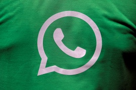 A logo of WhatsApp is pictured on a T-shirt worn by a WhatsApp-Reliance Jio representative during a drive by the two companies on the outskirts of Kolkata [File: Rupak De Chowdhuri/Reuters]